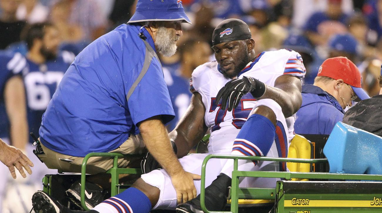 Buffalo Bills defensive end IK Enemkpali rides a cart to the locker room after an injury during the first half of a preseason NFL football game against the Indianapolis Colts Saturday, Aug. 13, 2016, in Orchard Park, N.Y. (AP Photo/Bill Wippert)