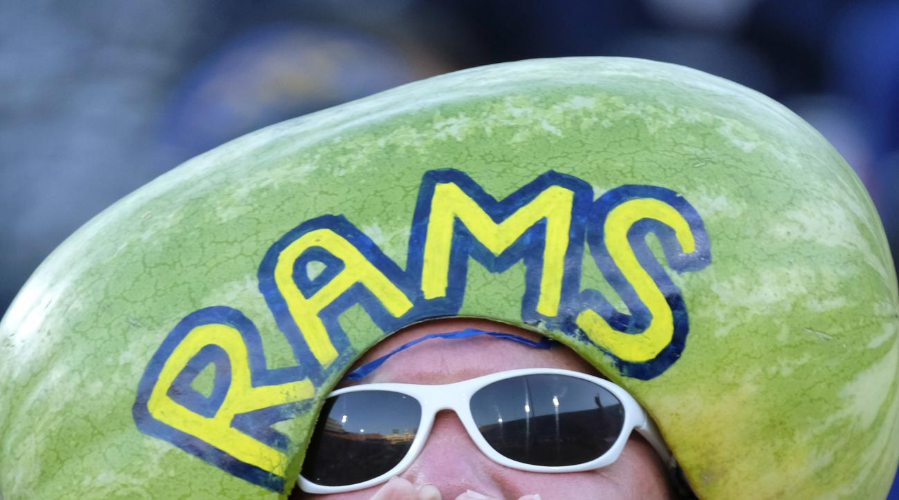 A Los Angeles Rams fan cheers as he wears a watermelon on his head during the first half of a preseason NFL football game against the Dallas Cowboys, Saturday, Aug. 13, 2016, in Los Angeles. (AP Photo/Richard Vogel)