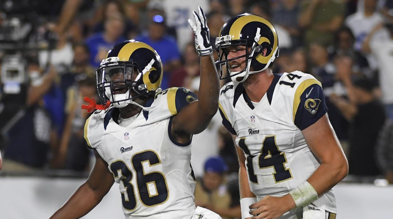 Los Angeles Rams running back Aaron Green (36) celebrates with quarterback Sean Mannion (14) after Green caught a pass from Mannion to score a touchdown against the Dallas Cowboys in the second half of a preseason NFL football game, Saturday, Aug. 13, 201