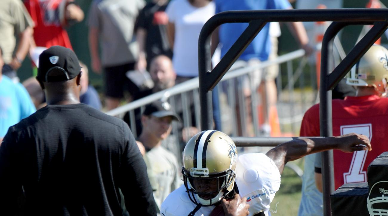 New Orleans Saints running back C.J. Spiller (28) runs the ball in a drill during the NFL football team's training camp in White Sulphur Springs, W.Va., Sunday, Aug. 14, 2016. (AP Photo/Chris Tilley)