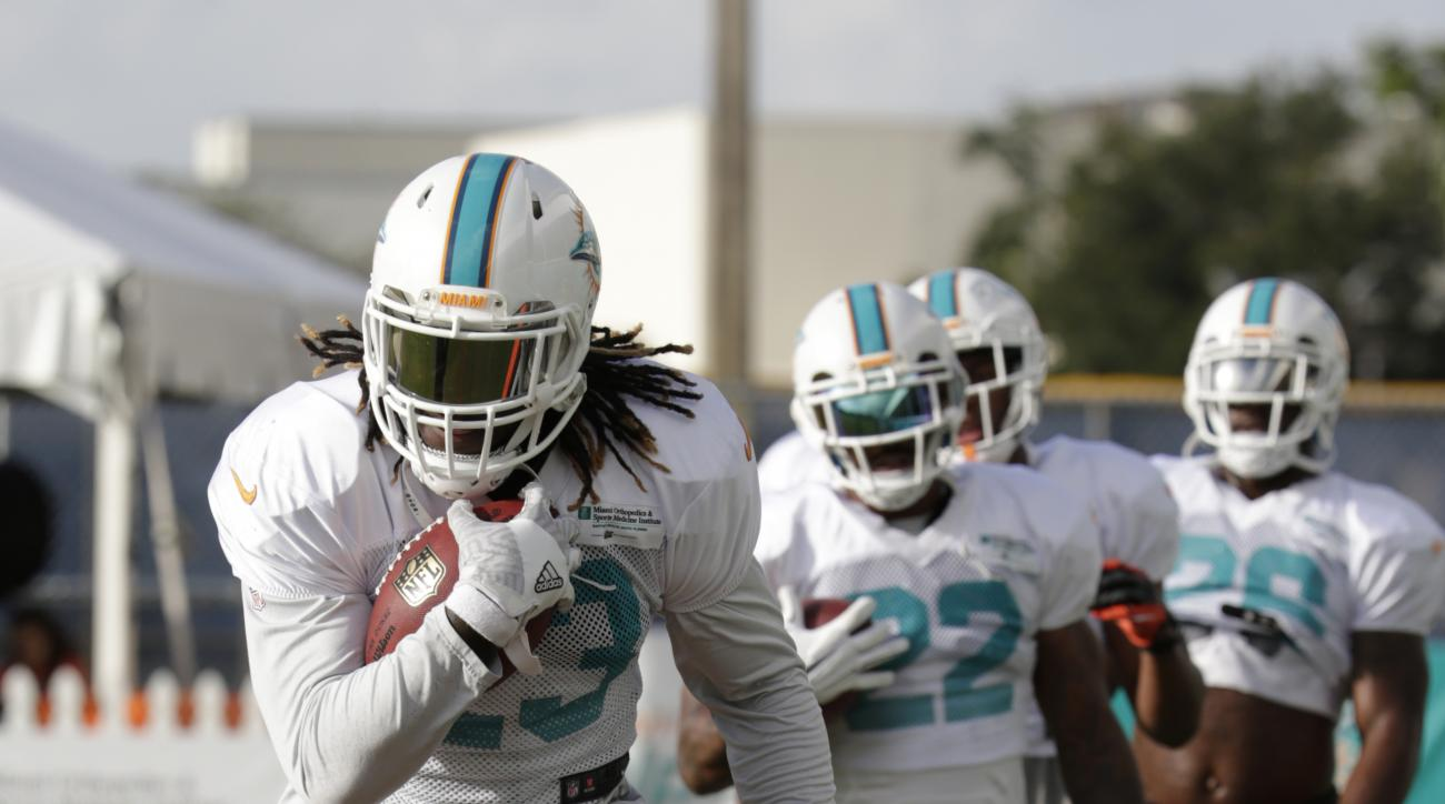 Miami Dolphins running back Jay Ajayi runs drills, Monday, Aug. 15, 2016, during practice at NFL football training camp in Davie, Fla. (AP Photo/Lynne Sladky)