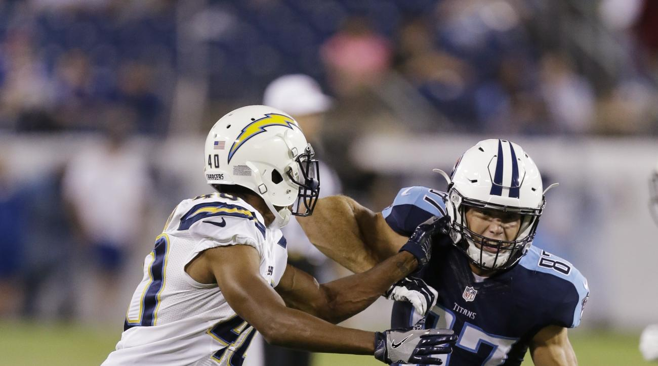 In this Saturday, Aug. 13, 2016 photo, Tennessee Titans wide receiver Reece Horn (87) works against the San Diego Chargers during the second half of an NFL preseason football game, in Nashville, Tenn. Horn was an intern with the Indianapolis Colts last se