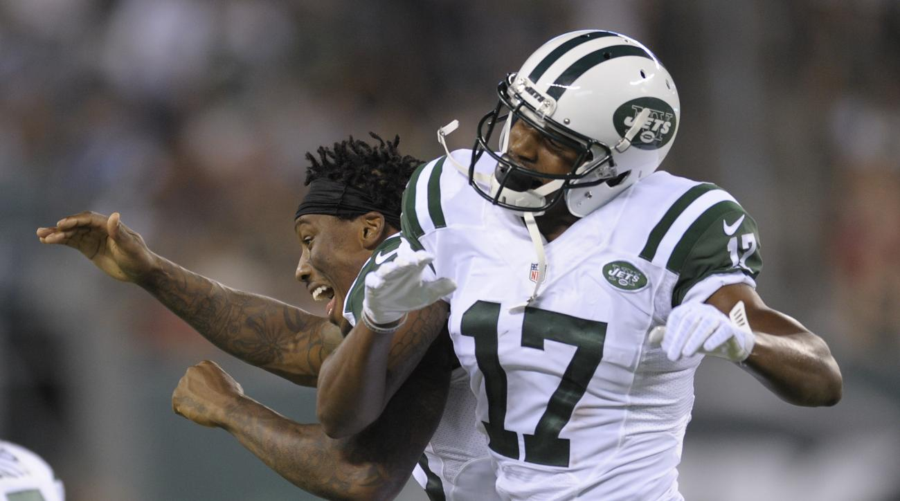 FILE - In this Aug. 11, 2016, file photo, New York Jets wide receiver Charone Peake (17) celebrates with a teammate after scoring a touchdown against the Jacksonville Jaguars during the second quarter of an NFL football game, in East Rutherford, N.J. Jali