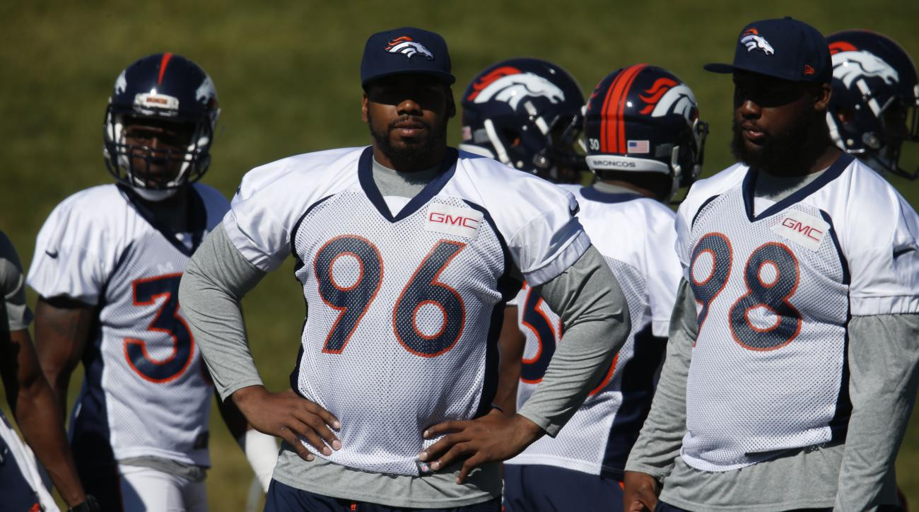 Denver Broncos defensive end Vance Walker (96), left, and Denver Broncos nose tackle Darius Kilgo (98) during drills at the team's NFL football training camp Saturday, Aug. 13, 2016 in Englewood, Colo. (AP Photo/David Zalubowski)