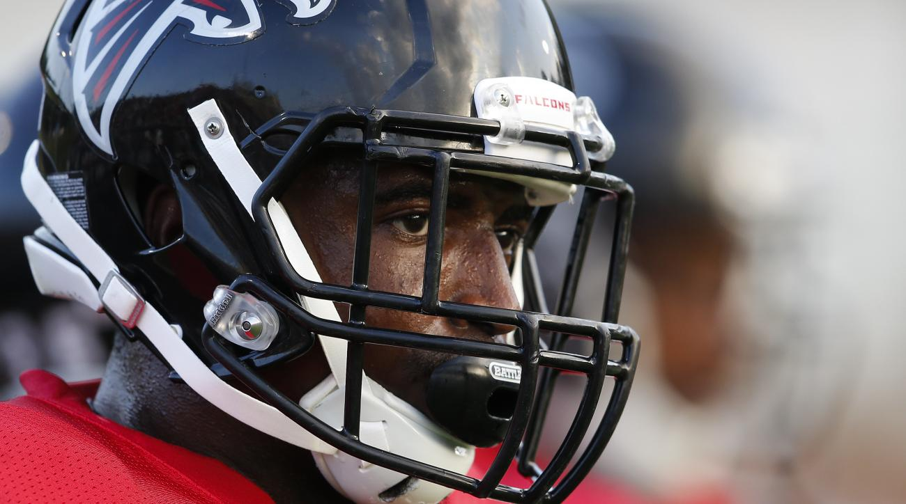 FILE - In this Aug. 5, 2016, file photo, Atlanta Falcons strong safety Keanu Neal (22) is shown during their annual Friday Night Lights NFL football practice at Grayson High School, in Loganville, Ga. Free-agent signee Dwight Freeney and rookie safety Kea