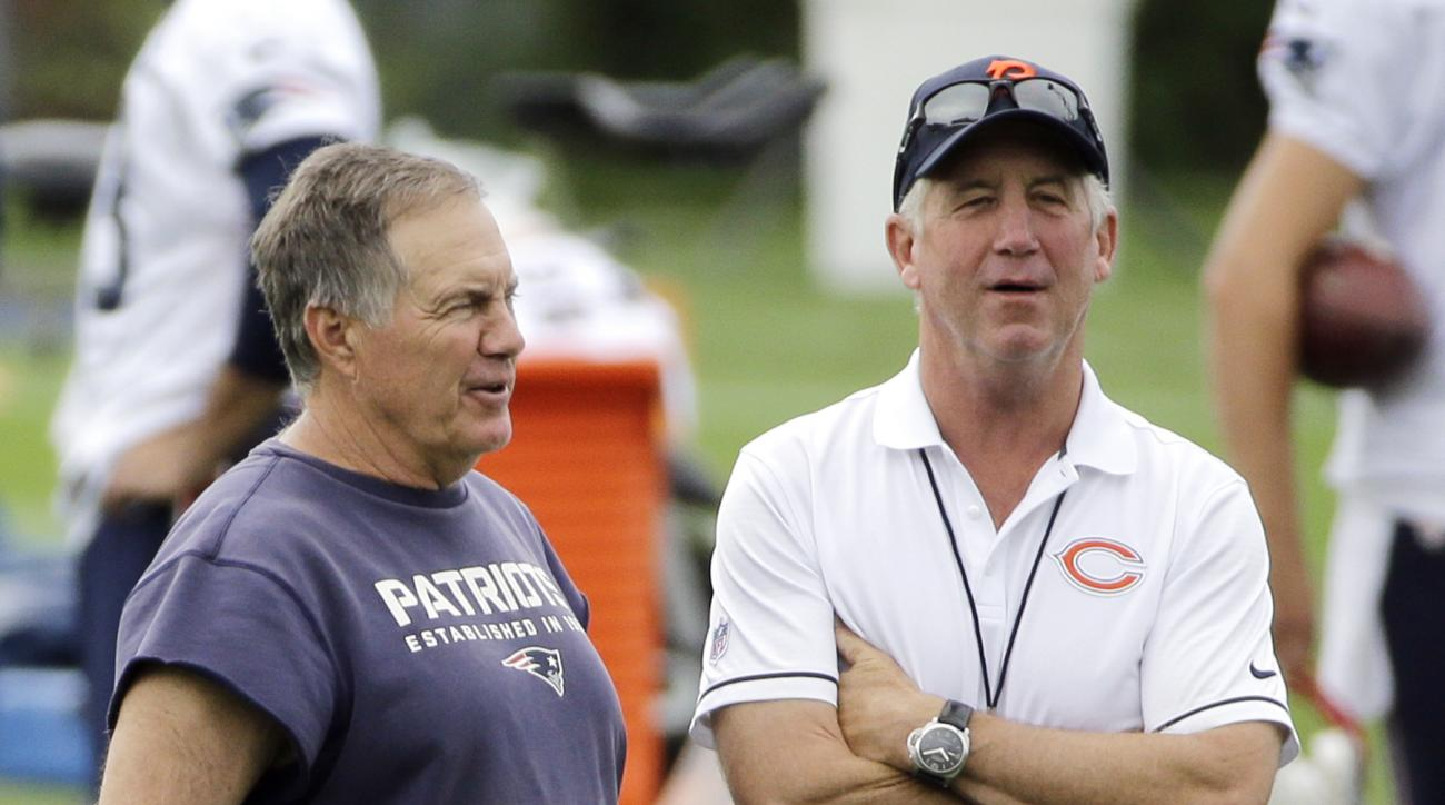 New England Patriots head coach Bill Belichick, left, and Chicago Bears head coach John Fox chat during NFL football training camp, Tuesday, Aug. 16, 2016, in Foxborough, Mass. (AP Photo/Elise Amendola)