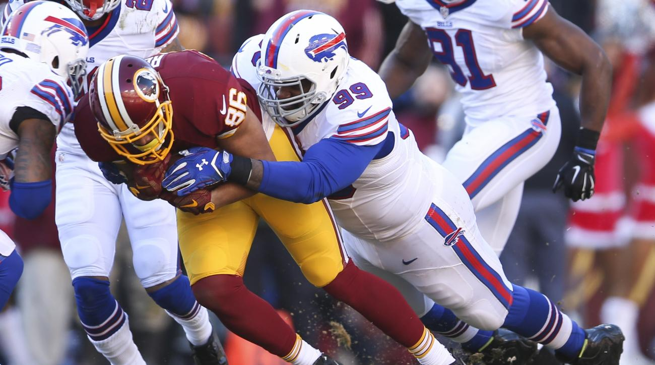 Washington Redskins tight end Jordan Reed (86) is tackled by Marcell Dareus during the first half of an NFL football game in Landover, Md., Sunday, Dec. 20, 2015. (AP Photo/Andrew Harnik)