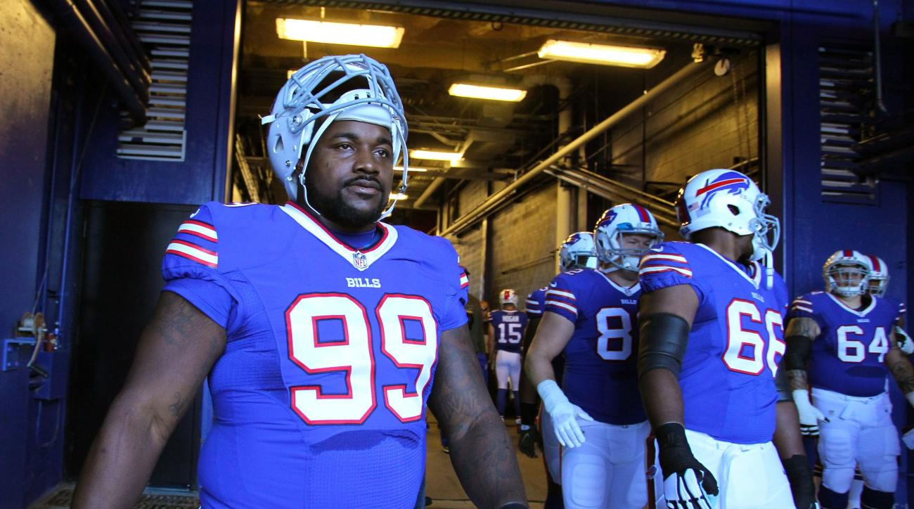 FILE - In this Nov. 8, 2015, file photo, Buffalo Bills defensive tackle Marcell Dareus (99) heads to the field before playing the Miami Dolphins in an NFL football game, in Orchard Park, N.Y. A person familiar with the decision tells The Associated Press