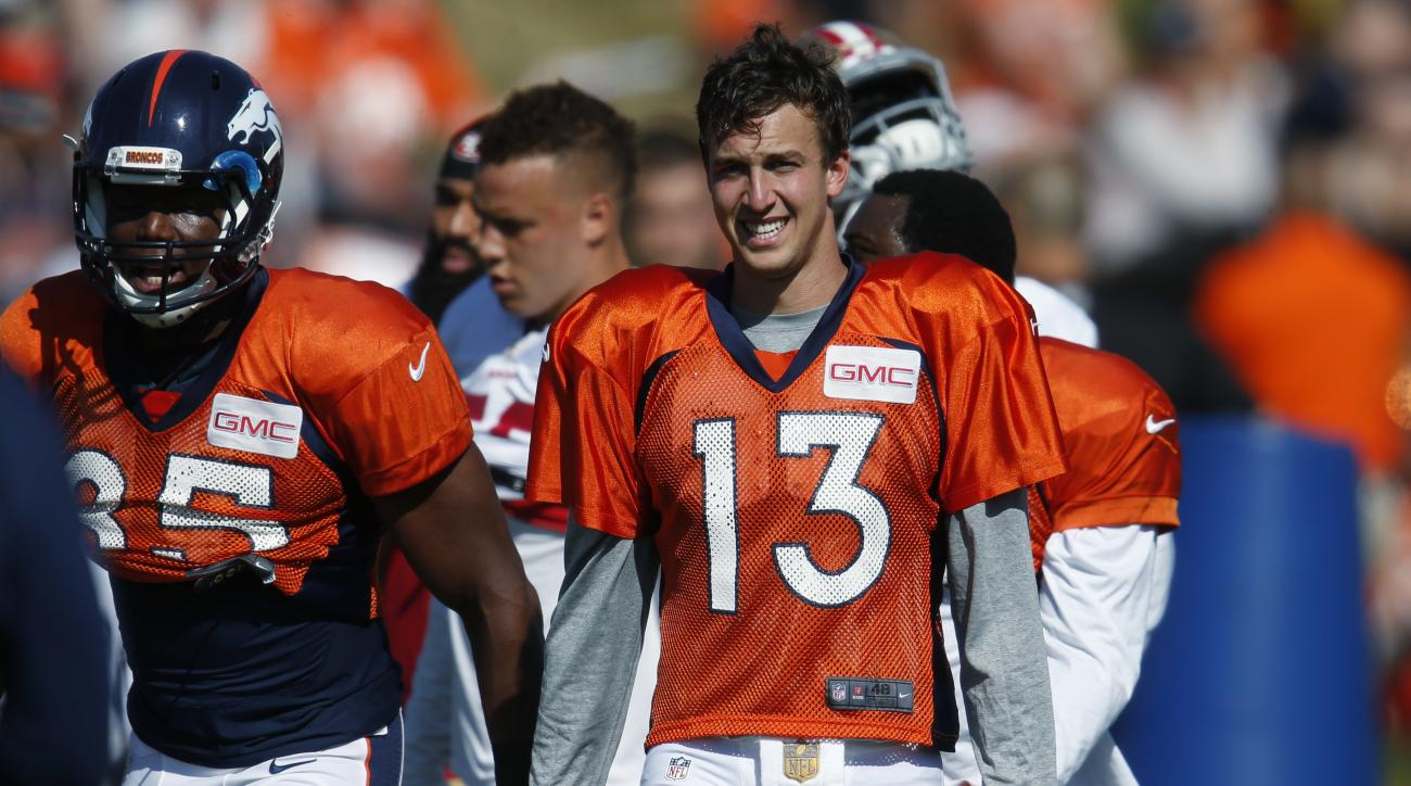Denver Broncos quarterback Trevor Siemian takes a break during drills with the San Francisco 49ers at the teams' NFL football training camp session Wednesday, Aug. 17, 2016 in Englewood, Colo. The Broncos host San Francisco on Saturday in an NFL exhibitio