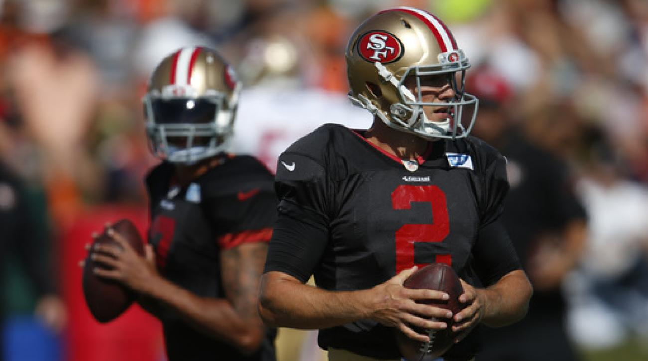 San Francisco 49ers quarterbacks Blaine Gabbert, front, and Colin Kaepernick look to throw the ball during drills before facing the Denver Broncos at the teams' NFL football training camp, Wednesday, Aug. 17, 2016, in Englewood, Colo. The Broncos host San