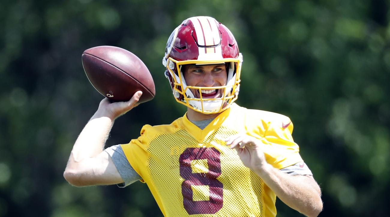 Washington Redskins quarterback Kirk Cousins (8) looks to throw the ball during practice at the team's NFL football training facility at Redskins Park, Wednesday, Aug. 17, 2016 in Ashburn, Va. (AP Photo/Alex Brandon)