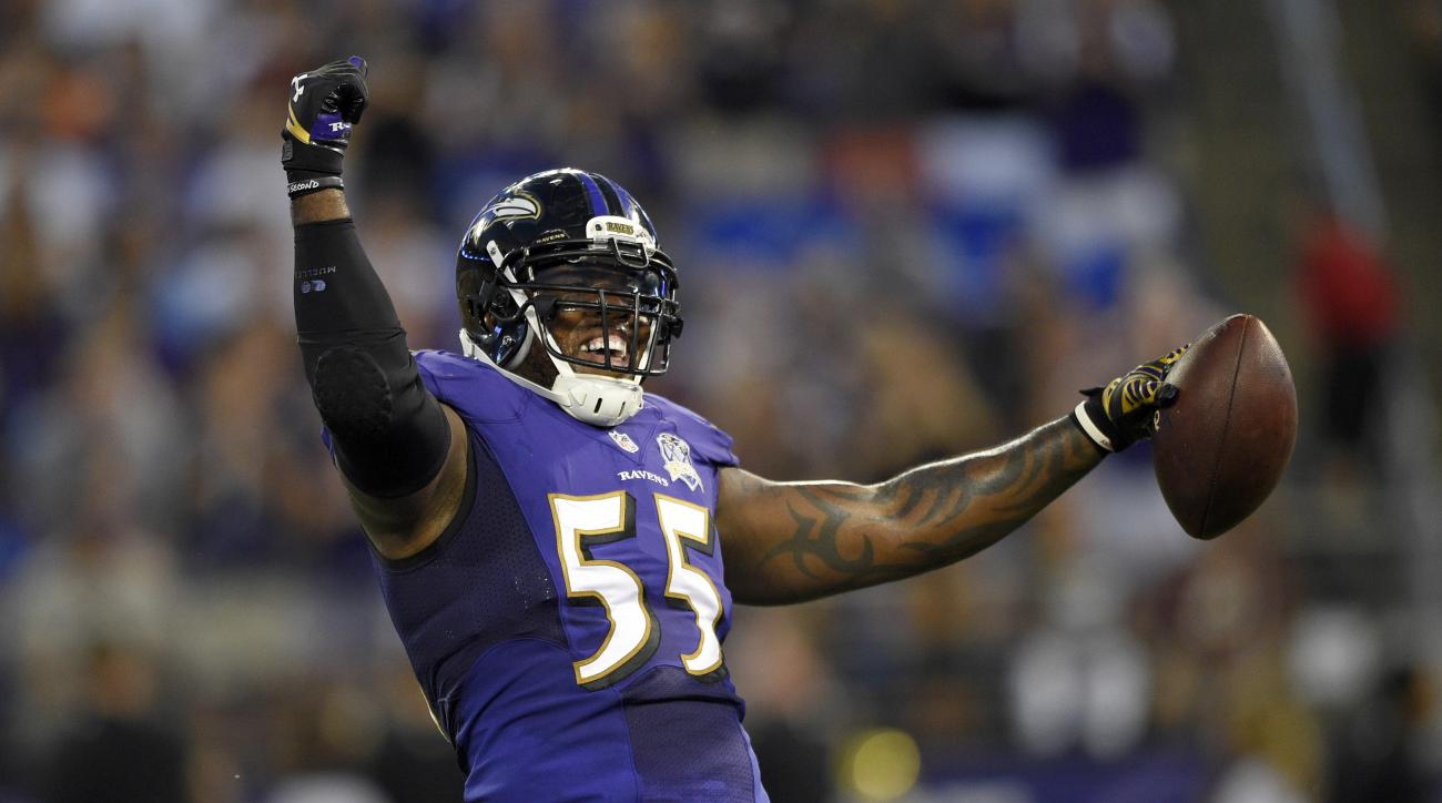 FILE - In this Aug. 29, 2015, file photo, Baltimore Ravens outside linebacker Terrell Suggs celebrates after intercepting a pass attempt by Washington Redskins quarterback Kirk Cousins in the first half of a preseason NFL football game, in Baltimore. Sugg