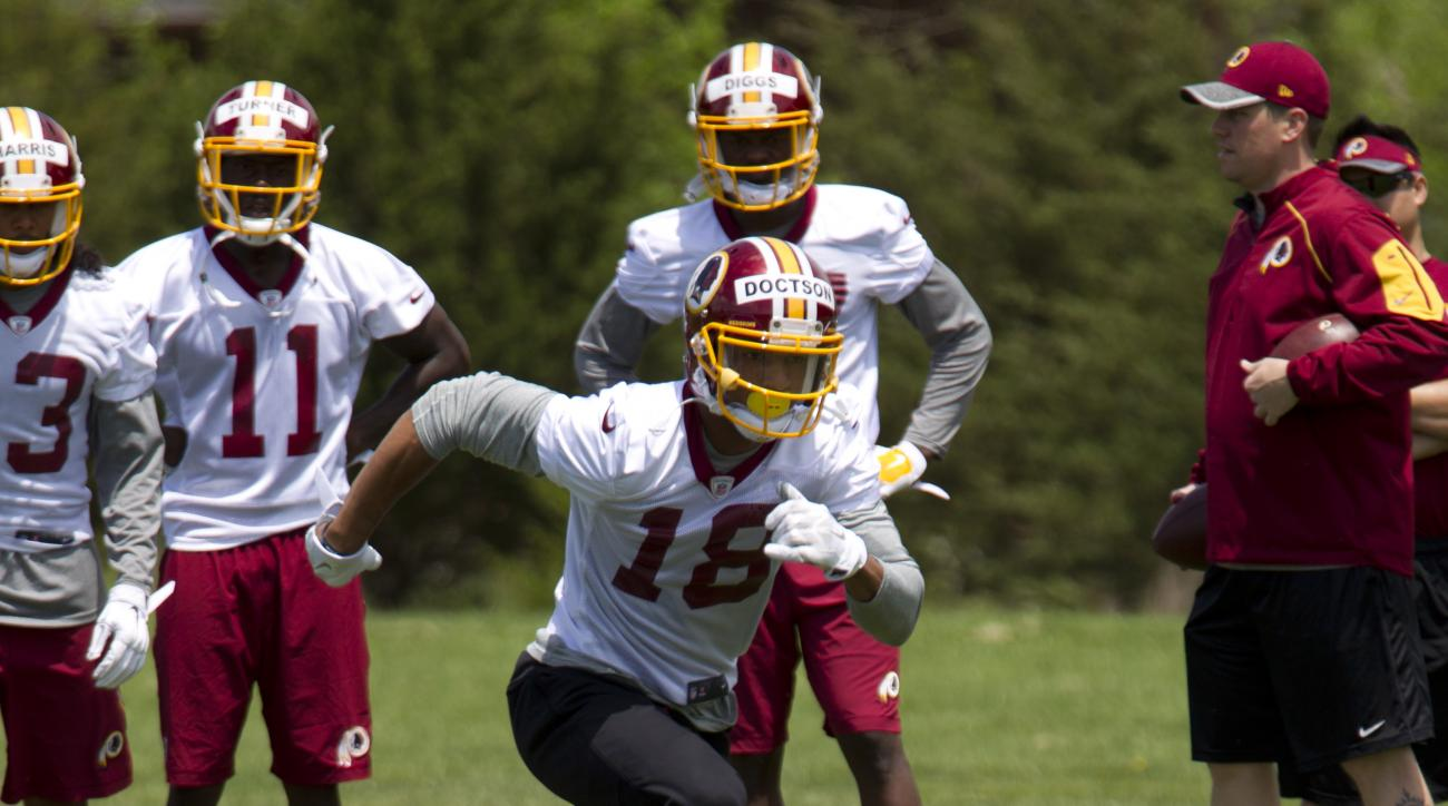 FILE - In this May 14, 2016 file photo, Washington Redskins wide receiver Josh Doctson, 18, works out during NFL football rookie minicamp in Ashburn, Va. Doctson is inching his way back from an Achilles tendon injury, though the Washington Redskins still