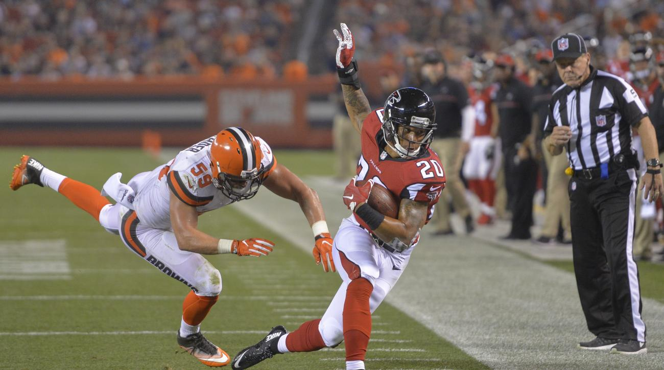 Atlanta Falcons running back Brandon Wilds (20) is pushed out of bounds by Cleveland Browns inside linebacker Tank Carder (59) during the first half of an NFL preseason football game Thursday, Aug. 18, 2016, in Cleveland. (AP Photo/David Richard)