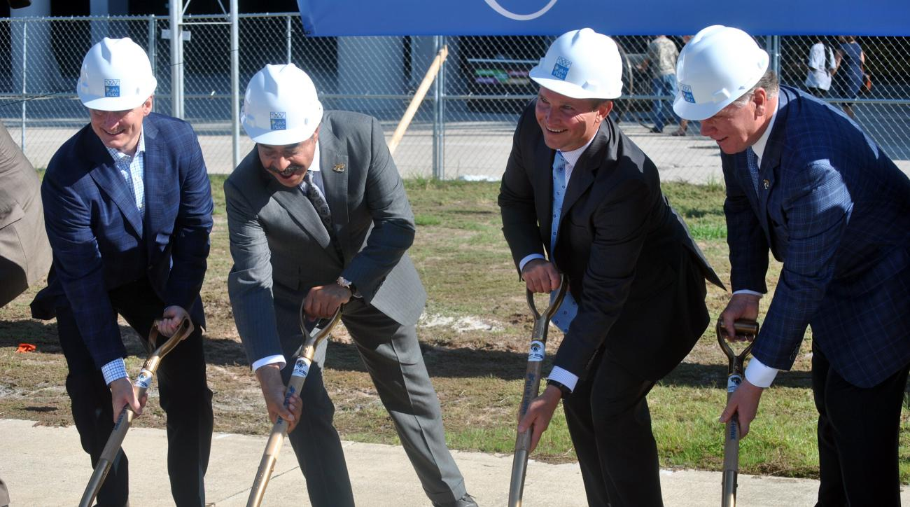 Daily's President and CEO Aubrey Edge, left, Jacksonville Jaguars NFL football team owner Shad Khan, Jacksonville Mayor Lenny Curry and Jaguars President Mark Lamping, right, break ground on the second phase of a $90 million upgrade to EverBank Field in J