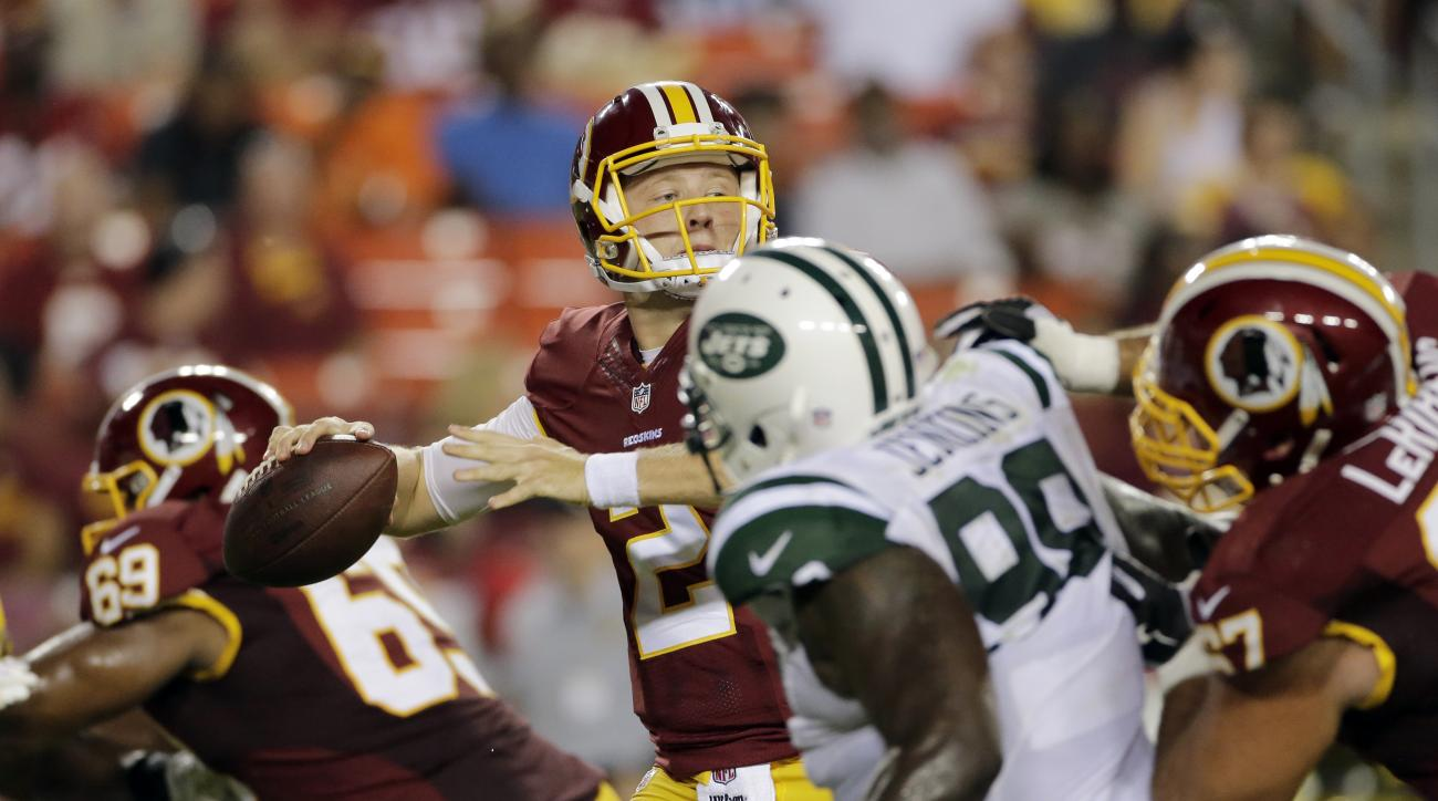 Washington Redskins quarterback Nate Sudfeld (2) looks to pass under pressure from New York Jets defensive tackle Jarvis Jenkins (98) during the second half of an NFL preseason football game Friday, Aug. 19, 2016, in Landover, Md. (AP Photo/Mark Tenally)