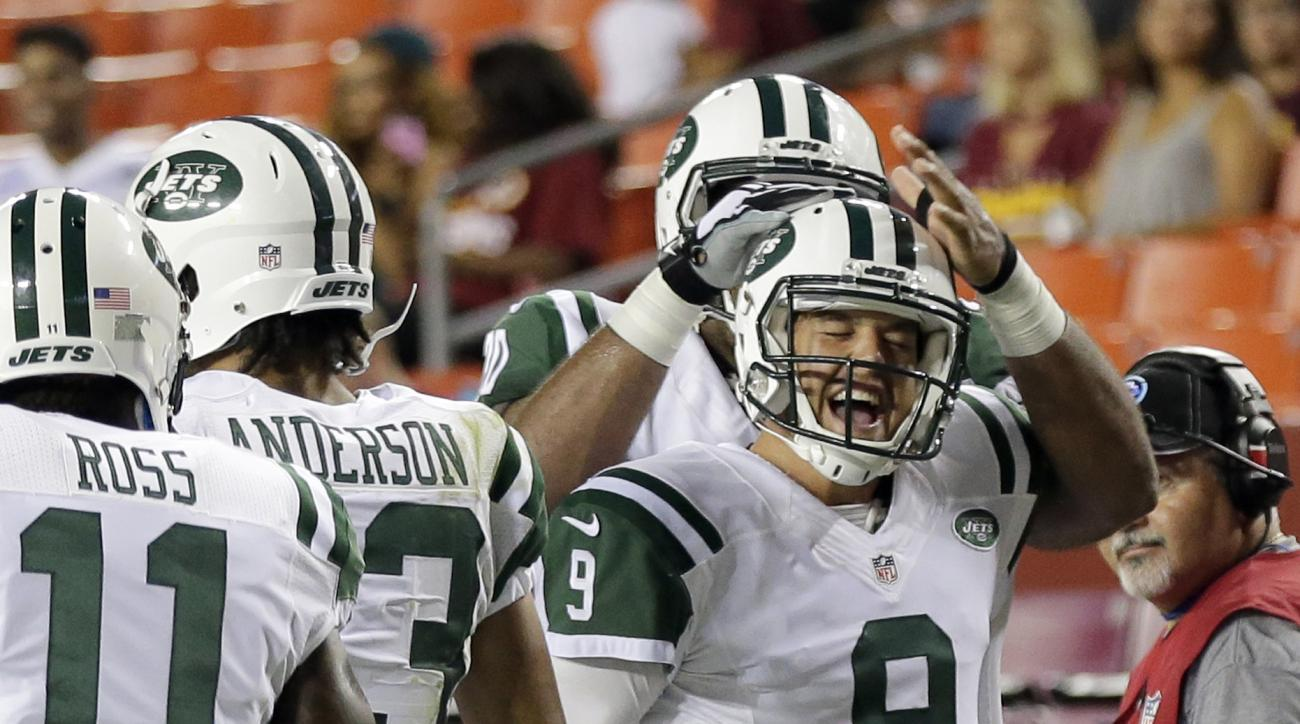 New York Jets quarterback Bryce Petty (9) celebrates with tackle Dakota Dozier, behind, and others after Petty's touchdown pass during the second half of an NFL preseason football game against the Washington Redskins, Friday, Aug. 19, 2016, in Landover, M