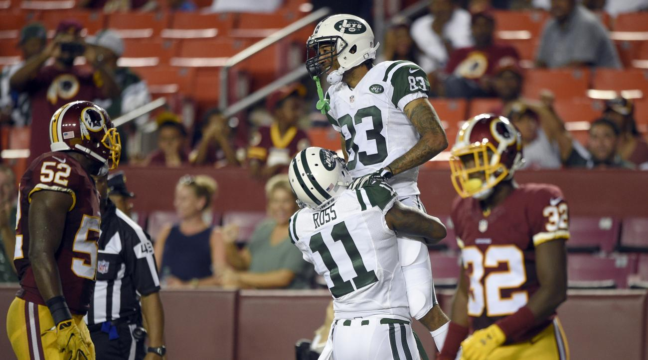 New York Jets wide receiver Jeremy Ross (11) picks up wide receiver Robby Anderson (83) after Anderson's touchdown during the second half of an NFL preseason football game against the Washington Redskins, Friday, Aug. 19, 2016, in Landover, Md. (AP Photo/