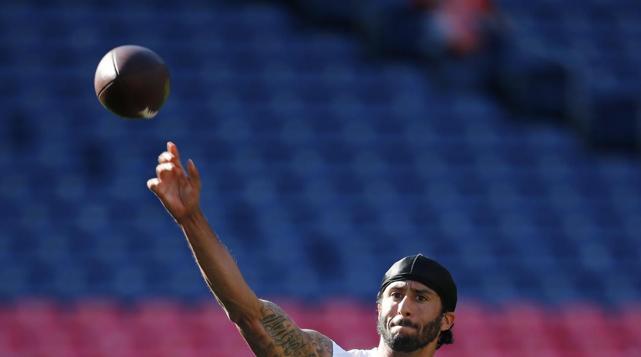 San Francisco 49ers quarterback Colin Kaepernick passes warms up for the team's preseason NFL football game against the Denver Broncos, Saturday, Aug. 20, 2016, in Denver. (AP Photo/Jack Dempsey)