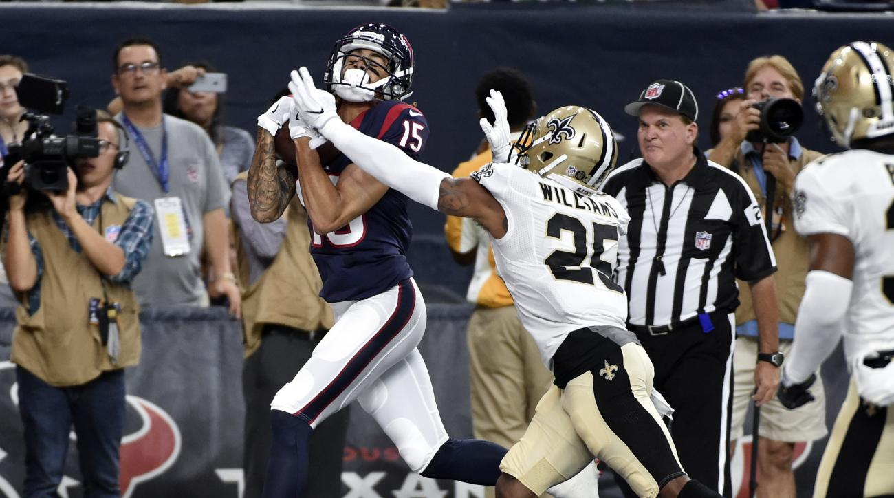 Houston Texans wide receiver Will Fuller (15) catches a touchdown pass as New Orleans Saints cornerback P.J. Williams (25) defends in the first half of an NFL preseason football game in Houston, Saturday, Aug. 20, 2016. (AP Photo/Eric Christian Smith)