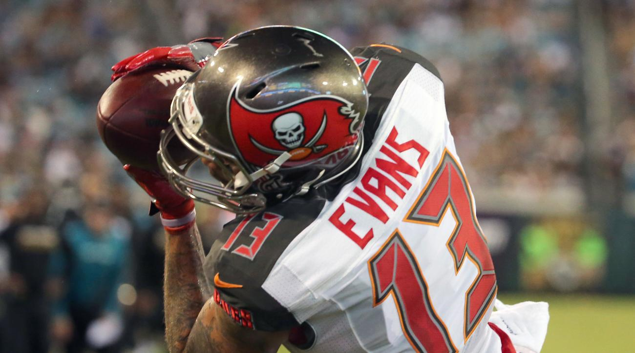 Tampa Bay Buccaneers wide receiver Mike Evans catches a 4-yard pass for a touchdown against the Jacksonville Jaguars during the first half of an NFL preseason football game in Jacksonville, Fla., Saturday, Aug. 20, 2016. (AP Photo/Stephen B. Morton)