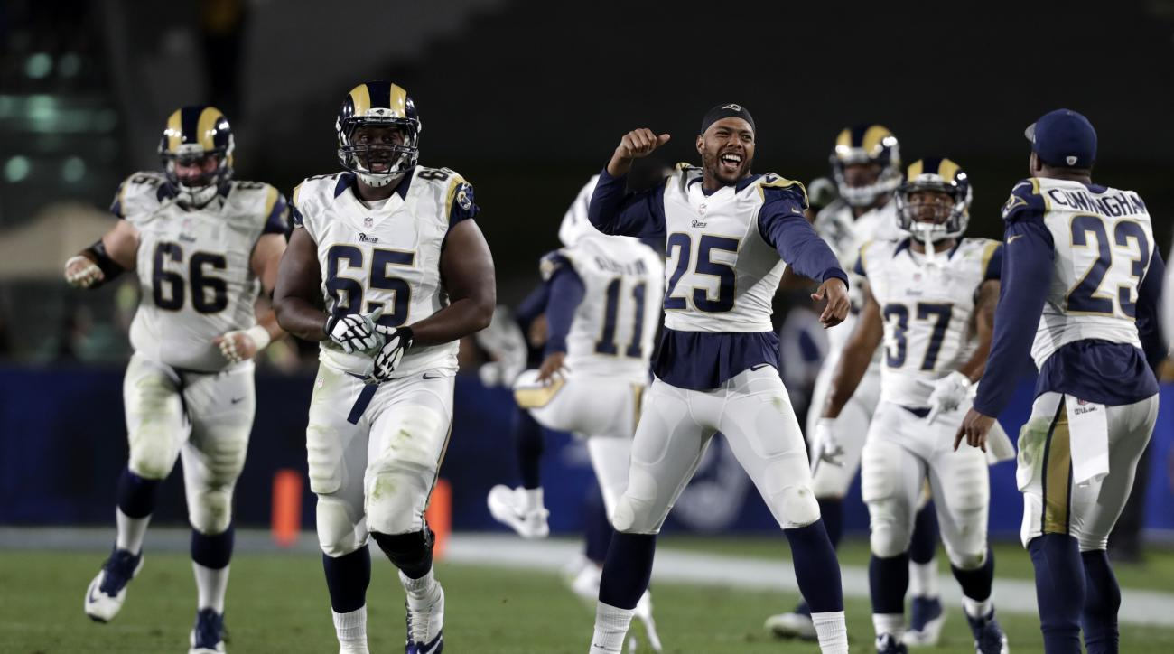 Members of the Los Angeles Rams celebrate after a fumble recovery by defensive back Jabriel Washington during the second half of a preseason NFL football game against the Kansas City Chiefs, Saturday, Aug. 20, 2016, in Los Angeles. (AP Photo/Ryan Kang)