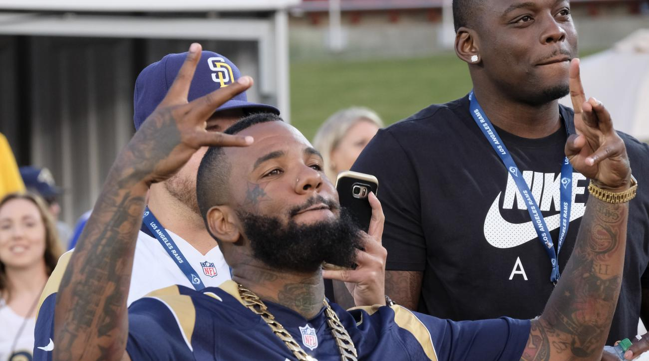 Rapper The Game reacts during a preseason NFL football game, between the Los Angeles Rams and the Kansas City Chiefs on Saturday, Aug. 20, 2016, in Los Angeles. (AP Photo/Richard Vogel)