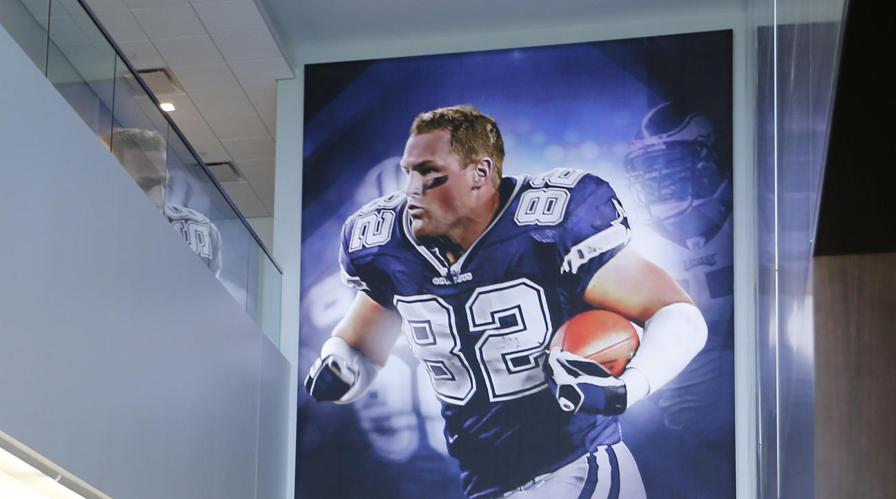 Dallas Cowboys Jason Witten smiles as he makes his way to the players area after looking at a photo of himself at the Dallas Cowboys new headquarters at The Star in Frisco, Texas, Sunday, Aug. 21, 2016. The Cowboys had their first workday Sunday at their