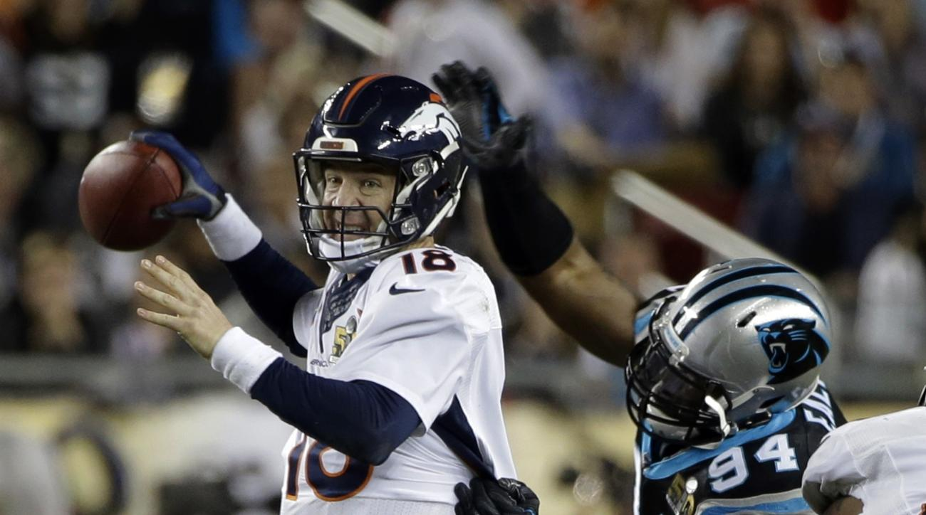 FILE - In this Feb. 7, 2016, file photo, Denver Broncos' Peyton Manning (18) loses the ball as he is hit by Carolina Panthers' Kony Ealy (94) during the second half of the NFL Super Bowl 50 football game, in Santa Clara, Calif. Ealy's breakout game on the