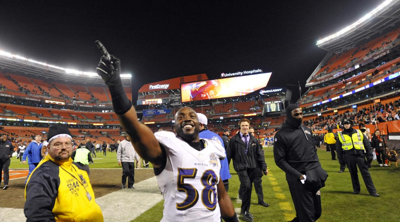 Baltimore Ravens outside linebacker Elvis Dumervil (58) celebrates after the Ravens defeated the Cleveland Browns 33-27 in an NFL football game, Monday, Nov. 30, 2015, in Cleveland. (AP Photo/David Richard)