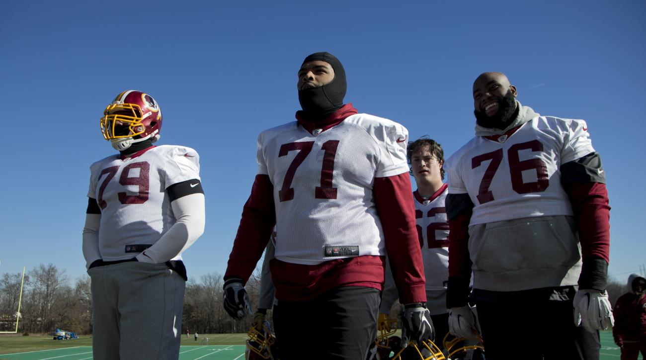 FILE - In this Jan. 6, 2016, file photo, Washington Redskins offensive tackle Trent Williams (71) leaves the field with teammates Ty Nsekhe (79), Morgan Moses (76), and Austin Reiter (62), at the end of a team practice at Redskins Park in Ashburn, Va. Wil