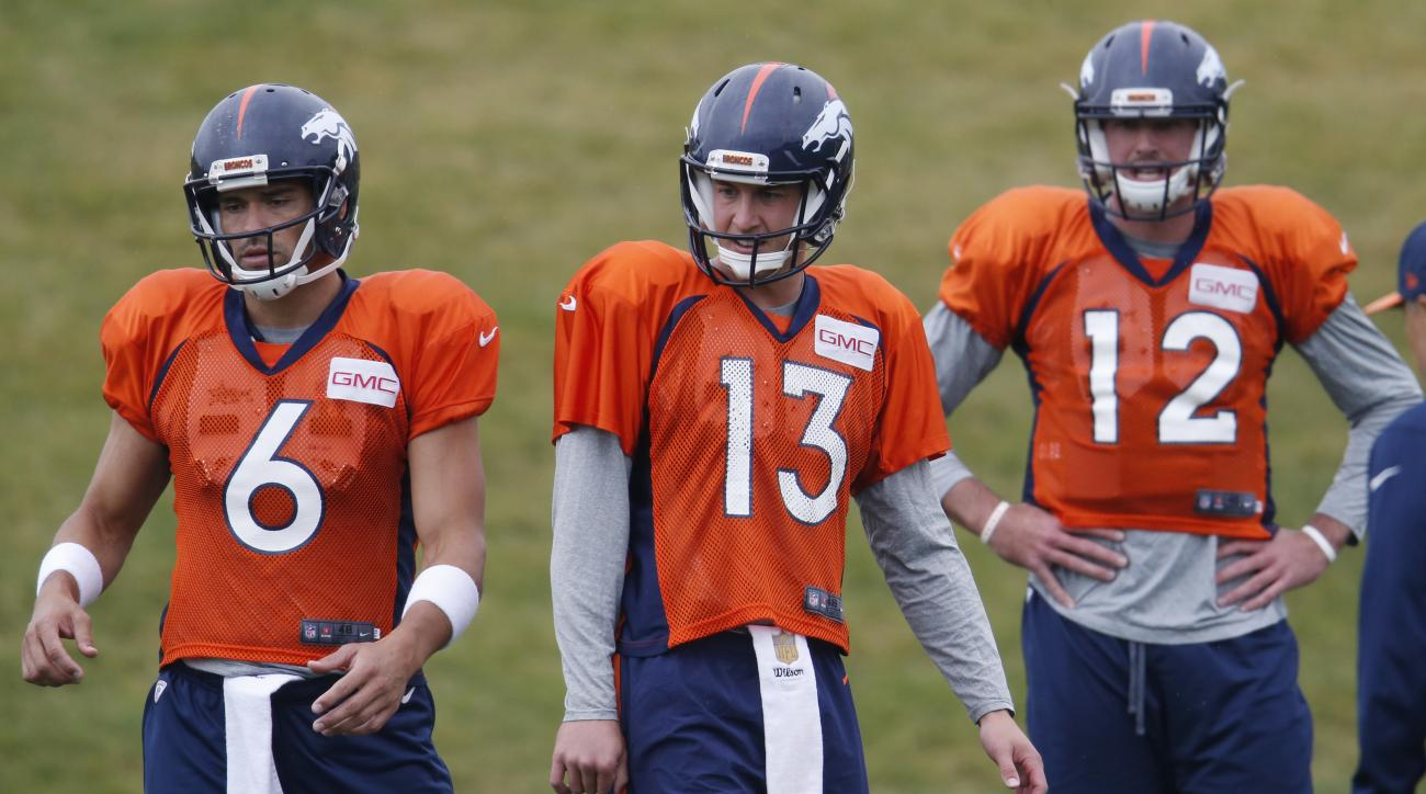 From left, Denver Broncos quarterbacks Mark Sanchez, Trevor Siemian and Paxton Lynch take part in drills during the team's NFL football practice at the Broncos' headquarters on Wednesday, Aug. 24, 2016, in Englewood, Colo. (AP Photo/David Zalubowski)