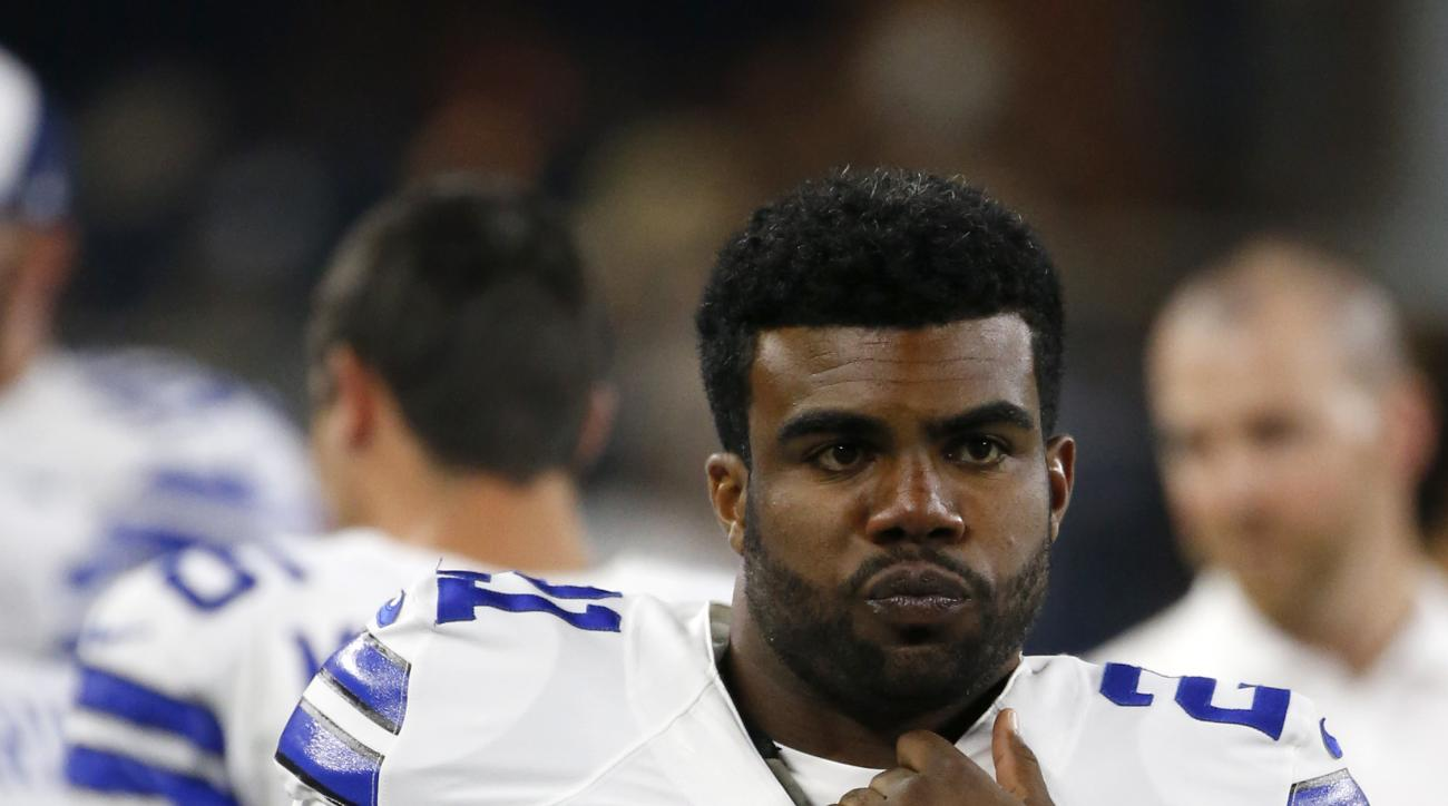 FILE - In this Aug. 19, 2016, file photo, Dallas Cowboys running back Ezekiel Elliott (21) stands on the sideline during the second half of an NFL preseason football game against the Miami Dolphins, in Arlington, Texas. Rookie Ezekiel Elliott is expected
