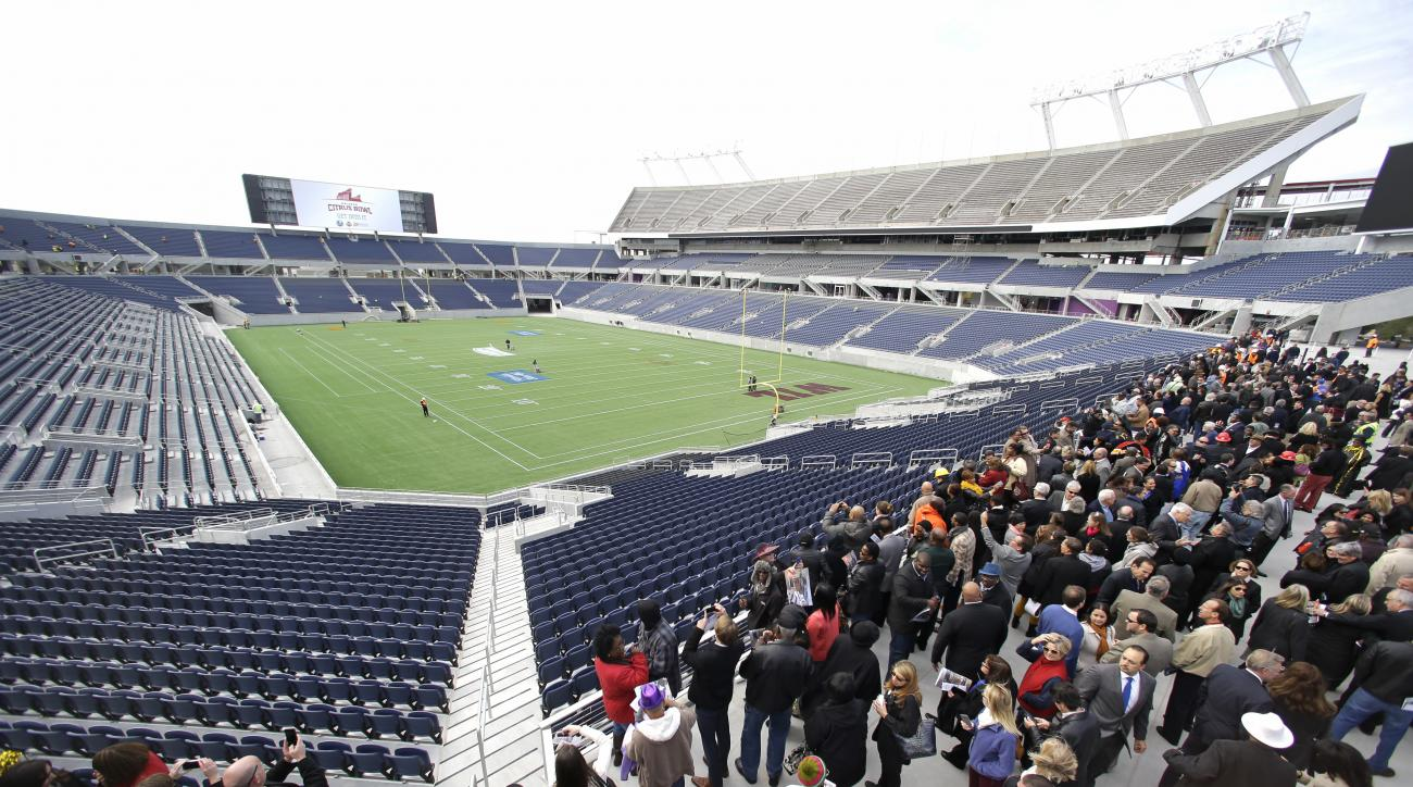 FILE - In this Nov. 19, 2014, file photo, city officials and guests get a preview of the new Citrus Bowl stadium, also known as Camping World Stadium, in Orlando, Fla. No NFL games have been played in the Citrus Bowl in nearly two decades. Atlanta and Mia