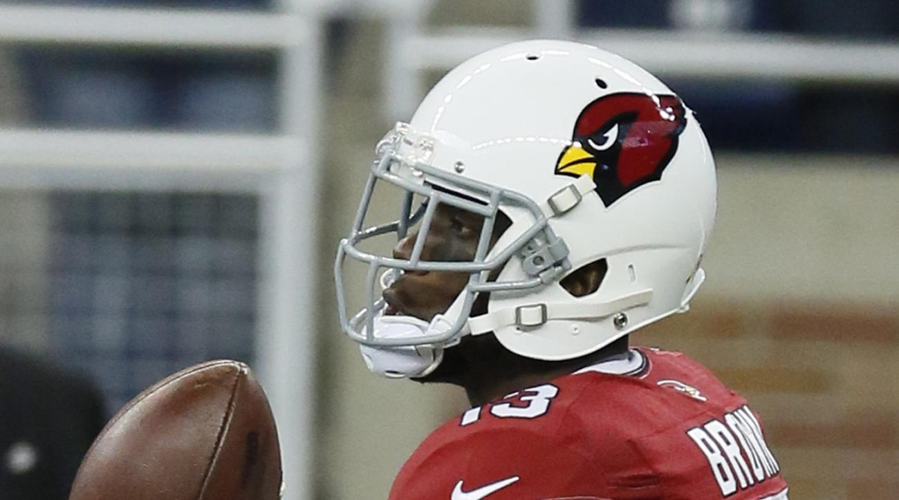 FILE - In this Oct. 11, 2015, file photo, Arizona Cardinals wide receiver Jaron Brown (13) catches a warmup pass before an NFL football game against the Detroit Lions, in Detroit. (AP Photo/Duane Burleson, File)