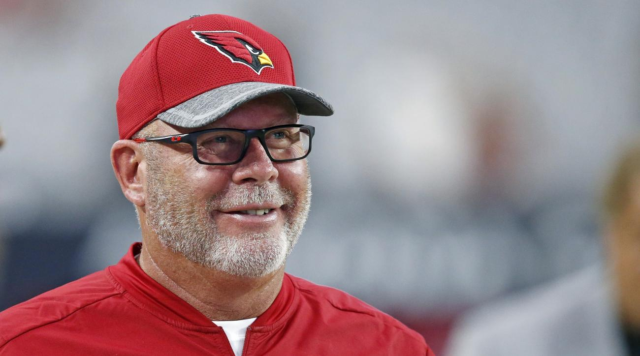 FILE - In this Aug. 12, 2016 file photo, Arizona Cardinals head coach Bruce Arians smiles as he paces the sidelines prior to an NFL preseason football game against the Oakland Raiders in Glendale, Ariz. John Elway, Bruce Arians and Tom Coughlin have been