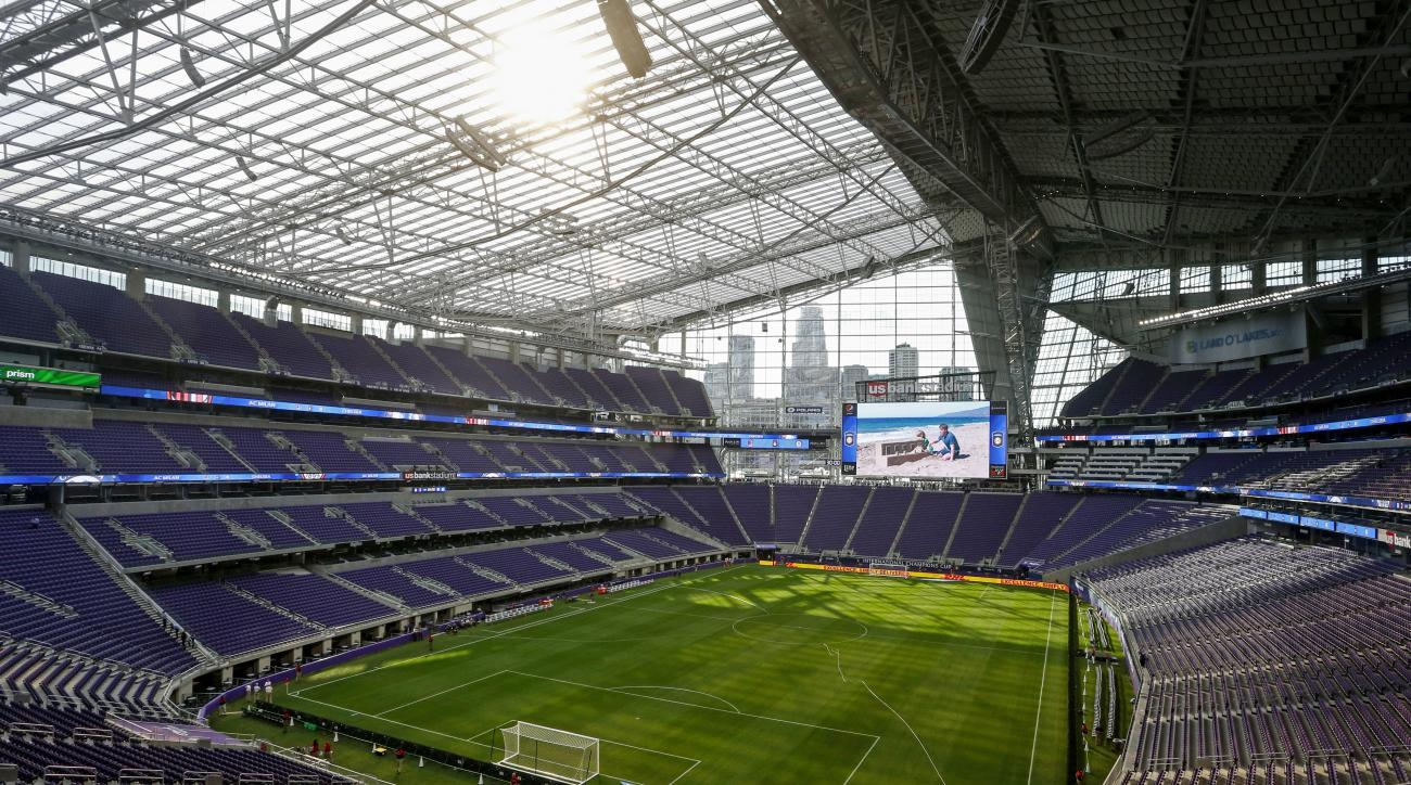 FILE - In this Aug. 3, 2016, file photo, U.S. Bank Stadium, new home of the Minnesota Vikings NFL football team, is seen before a friendly soccer match between Chelsea and AC Milan in Minneapolis. The Vikings have sold out their new stadium for the inaugu