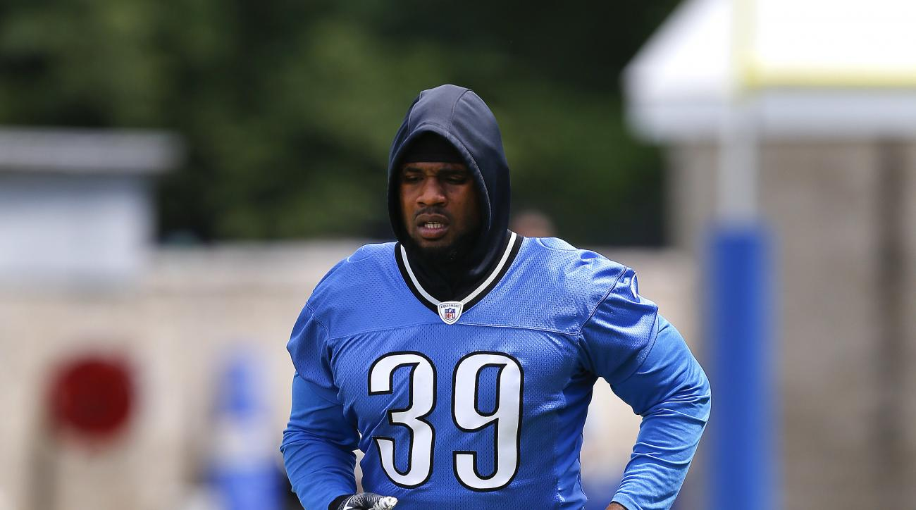 FILE - In this June 14, 2016, file photo, Detroit Lions running back Stevan Ridley runs during NFL football practice in Allen Park, Mich. The Lions have cut Ridley. They made the move Thursday, Aug. 25, before practice. Detroit signed Ridley in April, hop
