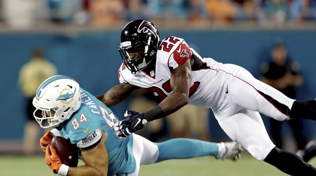 Miami Dolphins tight end Jordan Cameron (84) is brought down by Atlanta Falcons strong safety Keanu Neal (22) after a reception during the first half of an NFL preseason football game in Orlando, Fla., Thursday, Aug. 25, 2016.(AP Photo/Willie J. Allen Jr.