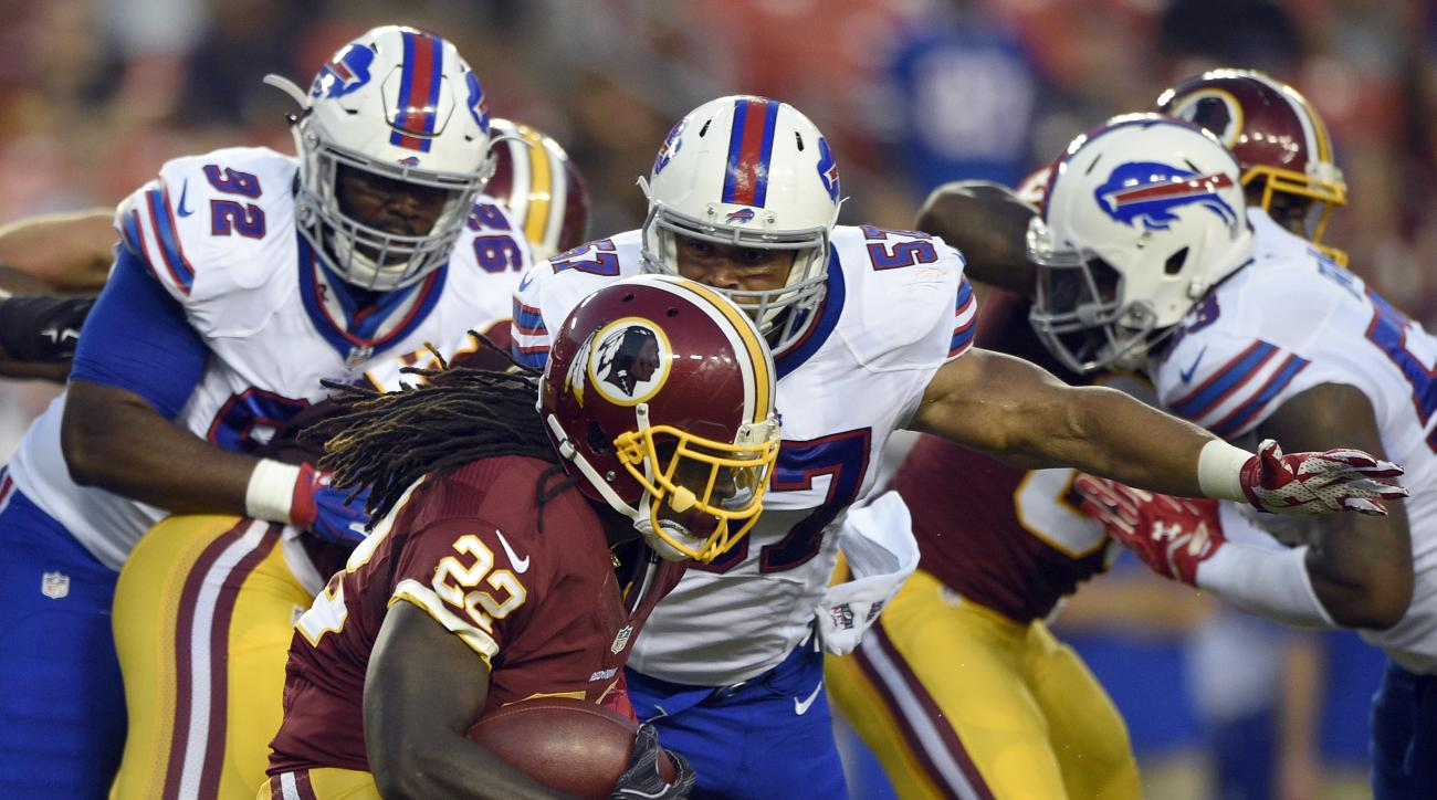 Washington Redskins running back Robert Kelley is wrapped up by Buffalo Bills linebacker Lorenzo Alexander (57) during the first half of an NFL preseason football game Friday, Aug. 26, 2016, in Landover, Md. (AP Photo/Nick Wass)