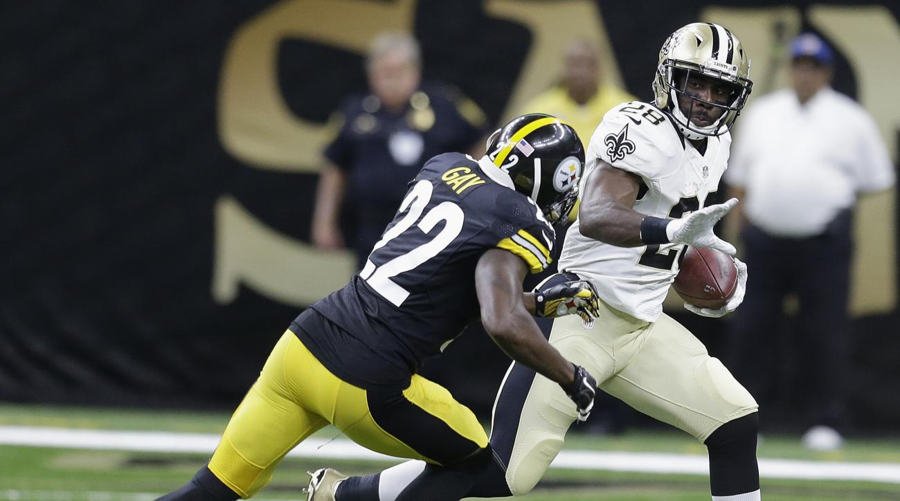 New Orleans Saints running back C.J. Spiller (28) runs against Pittsburgh Steelers cornerback William Gay (22) during the first half of an NFL preseason football game, Friday, Aug. 26, 2016, in New Orleans. (AP Photo/Butch Dill)