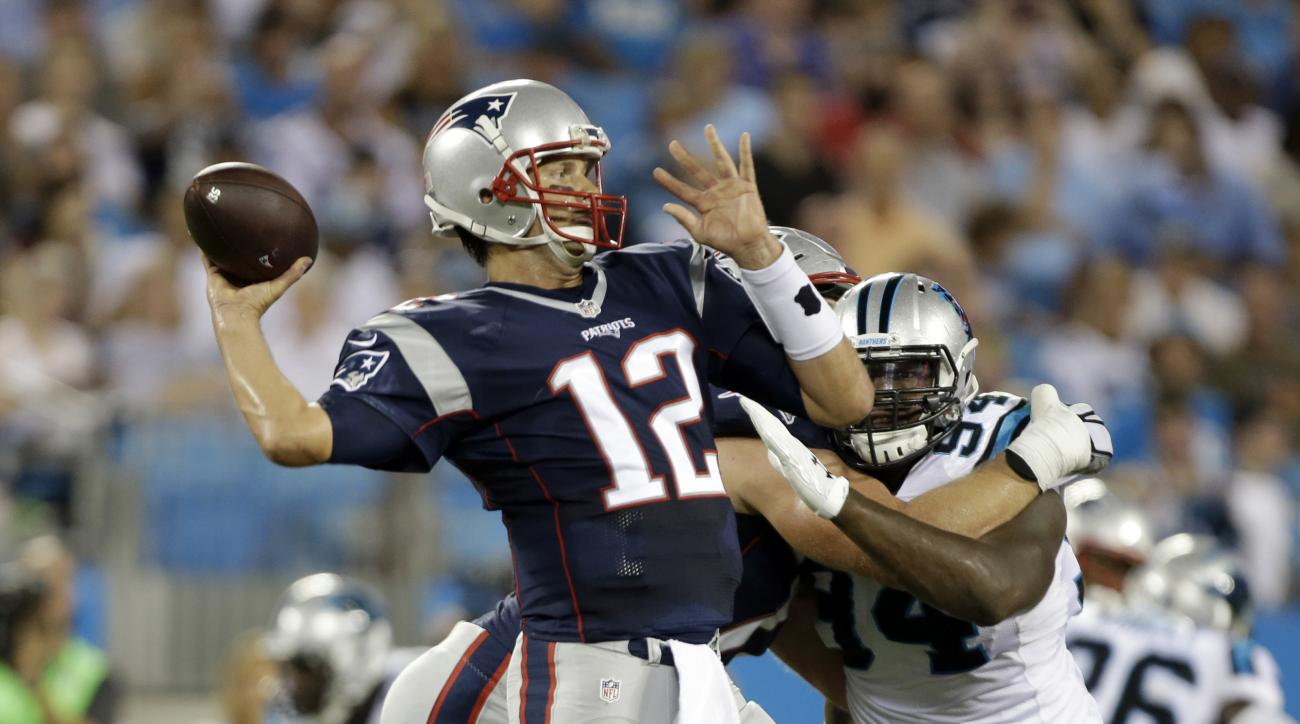 New England Patriots' Tom Brady (12) looks to pass against the Carolina Panthers during the first half of a preseason NFL football game in Charlotte, N.C., Friday, Aug. 26, 2016. (AP Photo/Bob Leverone)