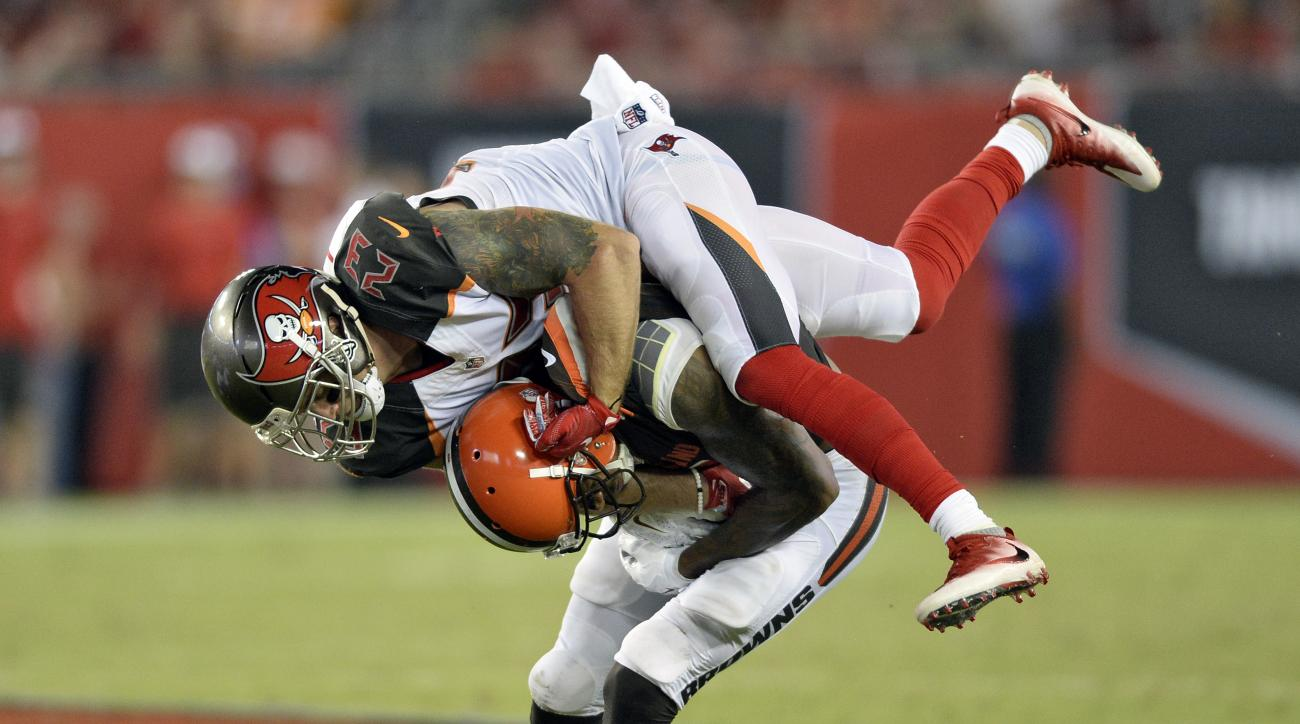 Tampa Bay Buccaneers strong safety Chris Conte (23) jumps on Cleveland Browns wide receiver Terrelle Pryor (11) after a reception during the second quarter of an NFL preseason football game Friday, Aug. 26, 2016, in Tampa, Fla. (AP Photo/Jason Behnken)