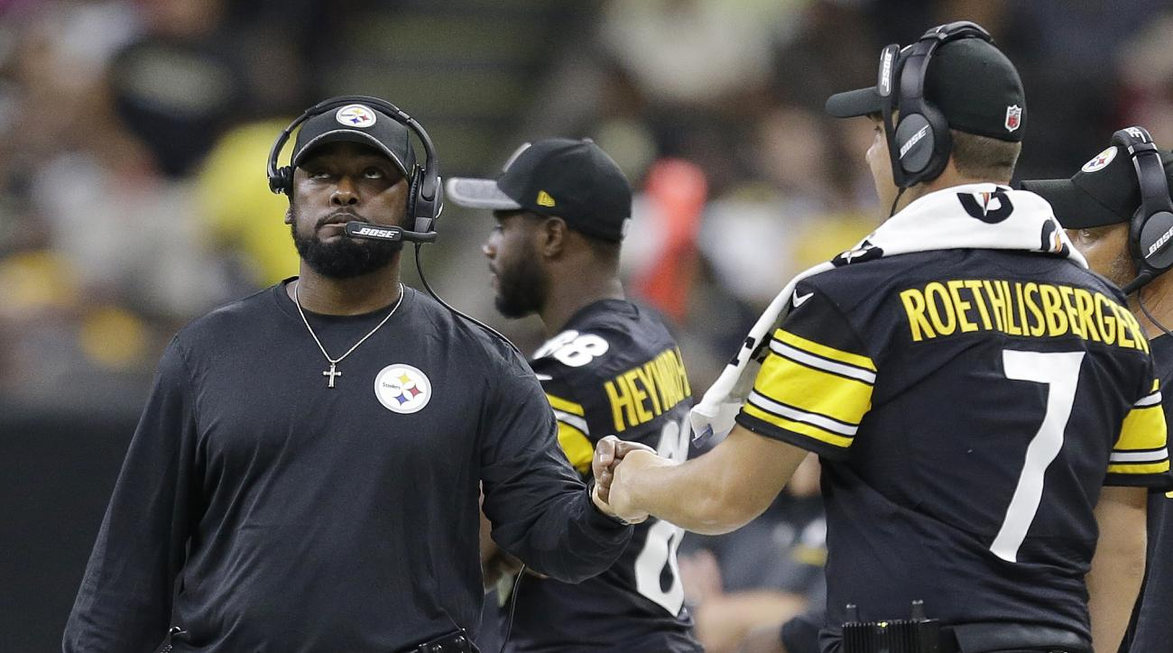 Pittsburgh Steelers head coach Mike Tomlin fist bumps Pittsburgh Steelers quarterback Ben Roethlisberger during the second half of an NFL preseason football game against the New Orleans Saints, Friday, Aug. 26, 2016, in New Orleans. (AP Photo/Butch Dill)