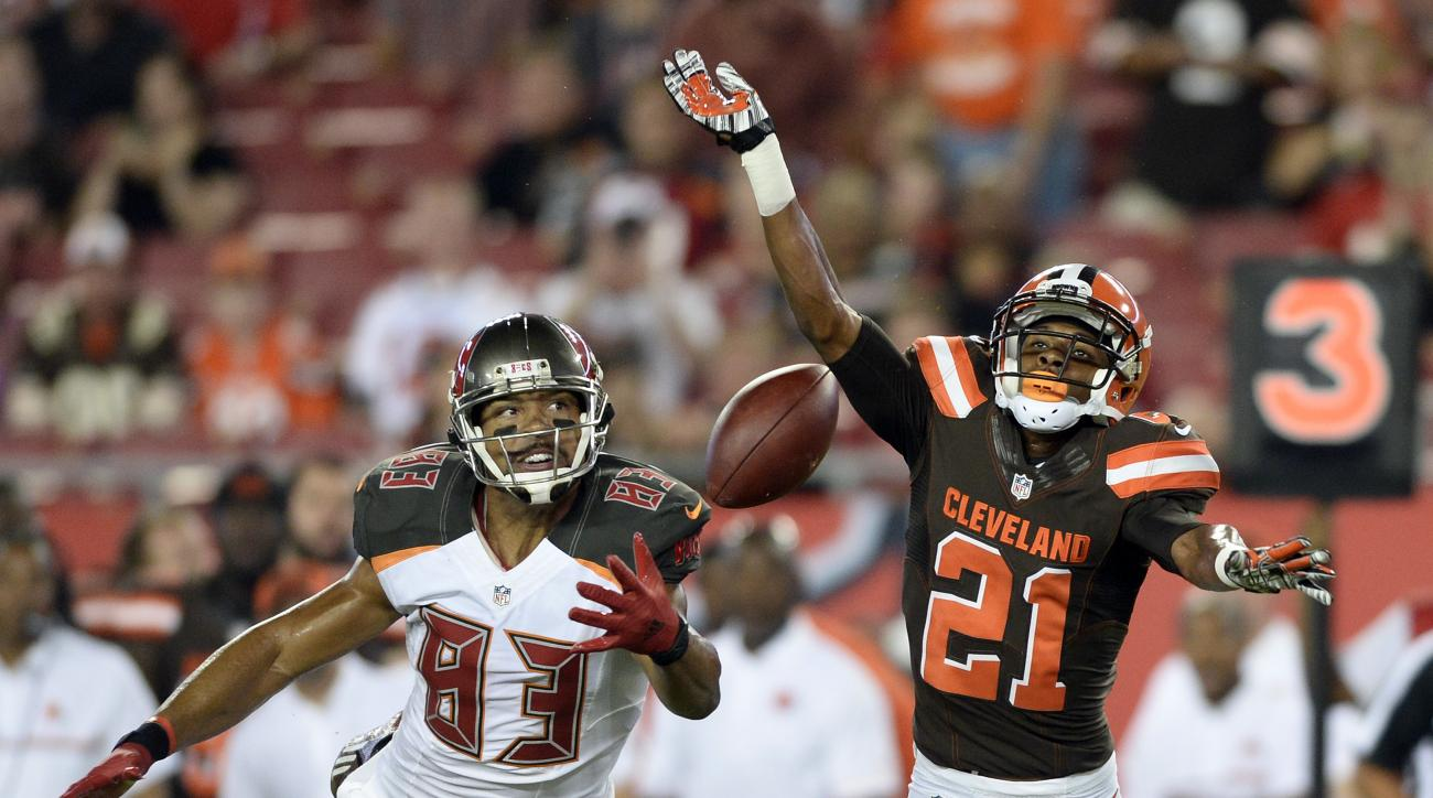Cleveland Browns cornerback Justin Gilbert (21) knocks a pass away from Tampa Bay Buccaneers wide receiver Vincent Jackson (83) during the first half of an NFL football game Friday, Aug. 26, 2016, in Tampa, Fla. (AP Photo/Jason Behnken)