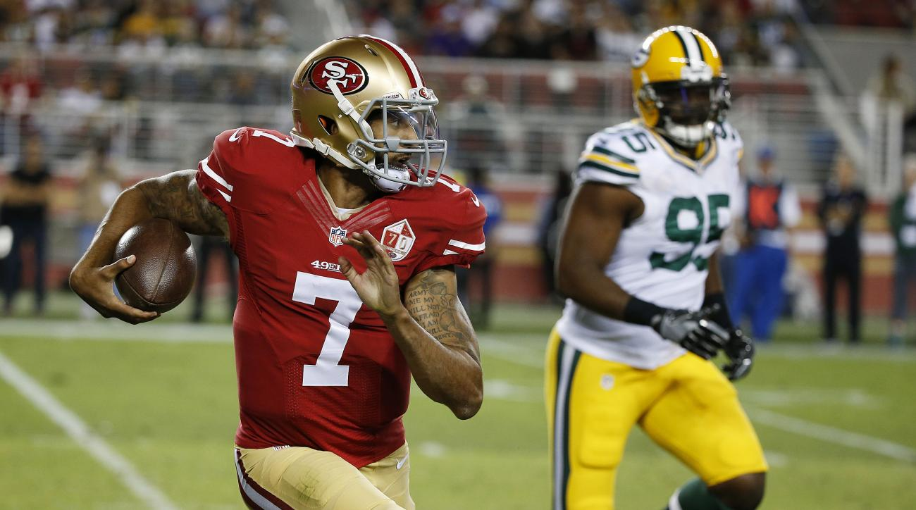 San Francisco 49ers quarterback Colin Kaepernick, left, runs with the ball as Green Bay Packers defensive end Datone Jones pursues during the first half of an NFL preseason football game Friday, Aug. 26, 2016, in Santa Clara, Calif. (AP Photo/Tony Avelar)