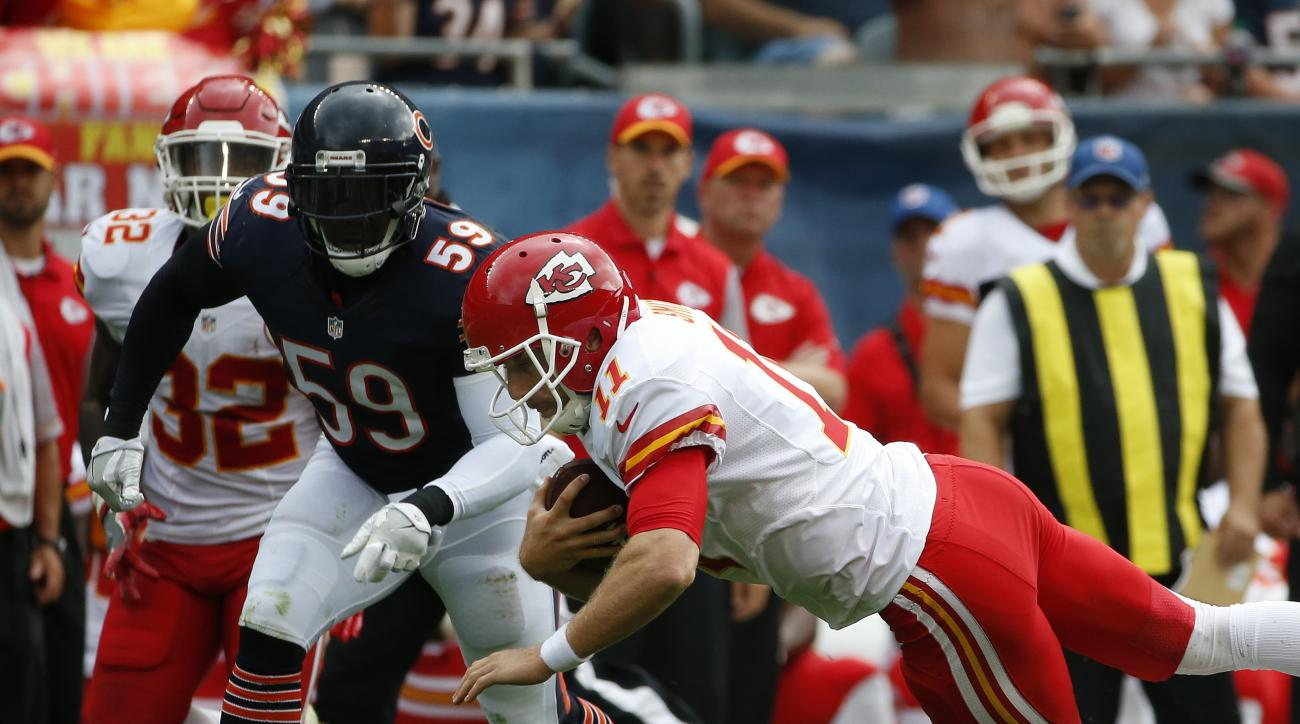 Kansas City Chiefs quarterback Alex Smith (11) dives as he carries the ball against Chicago Bears linebacker Danny Trevathan (59) during the first half of an NFL preseason football game, Saturday, Aug. 27, 2016, in Chicago. (AP Photo/Nam Y. Huh)