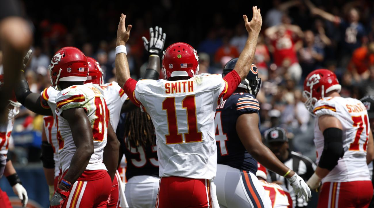 Kansas City Chiefs quarterback Alex Smith (11) celebrates a touchdown during the first half of an NFL preseason football game against the Chicago Bears, Saturday, Aug. 27, 2016, in Chicago. (AP Photo/Nam Y. Huh)