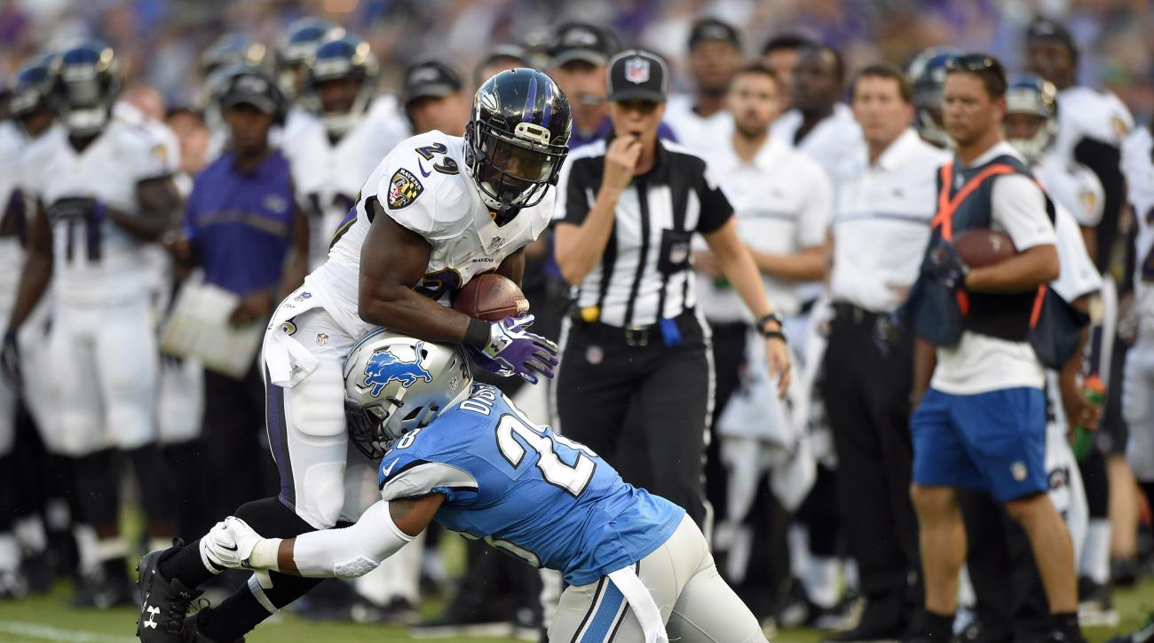 Baltimore Ravens running back Justin Forsett, left, is tackled by Detroit Lions cornerback Quandre Diggs in the first half of a preseason NFL football game, Saturday, Aug. 27, 2016, in Baltimore. (AP Photo/Nick Wass)