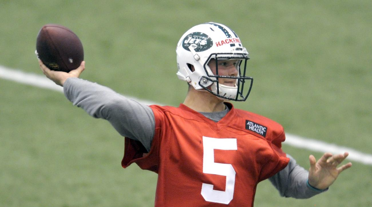FILE - In a Friday, May 6, 2016 file photo, New York Jets second round draft pick Christian Hackenberg throws a pass during NFL football rookie minicamp, in Florham Park, N.J. The second-round draft pick from Penn State had an up-and-down NFL debut in the